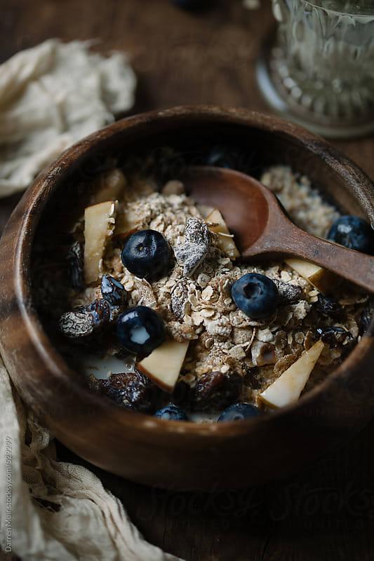 Bowl of muesli with blueberry and apple for breakfast. by Darren Muir for Stocksy United