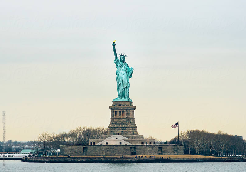 Statue of Liberty at sunset by Deirdre Malfatto for Stocksy United