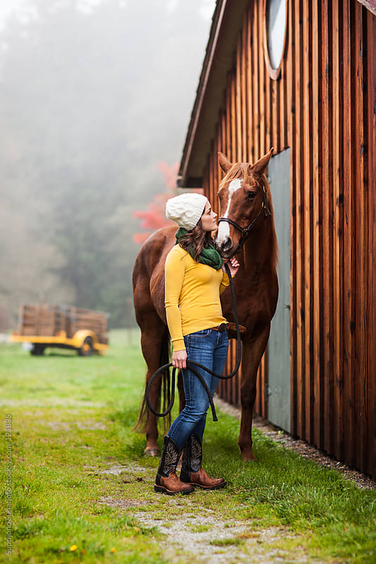 Woman and her horse outside on the field by Suprijono Suharjoto for Stocksy United