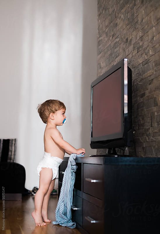 One Year Old Boy Watching TV by Mosuno for Stocksy United