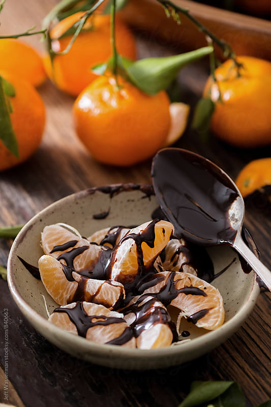 Clementine Oranges Segments with Chocolate by Jeff Wasserman for Stocksy United