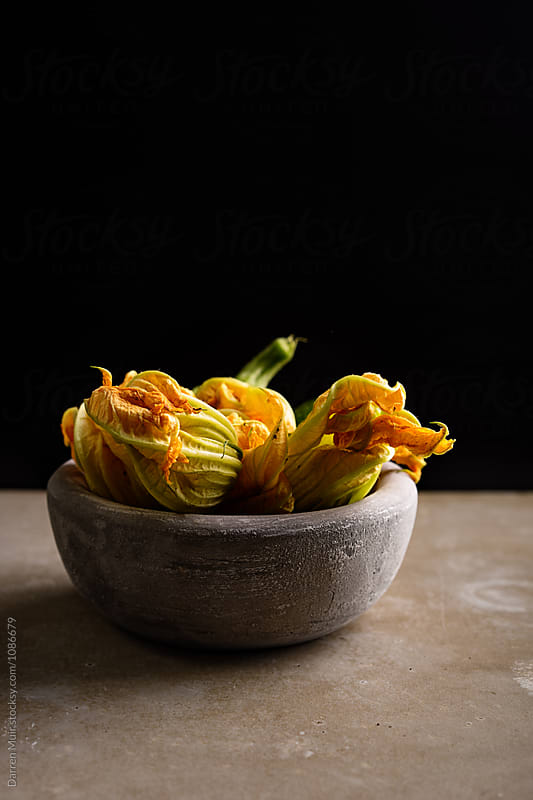 Courgette flowers. by Darren Muir for Stocksy United