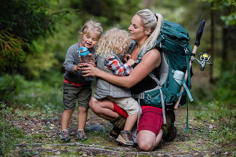 hiking mother and children by Andreas Gradin for Stocksy United