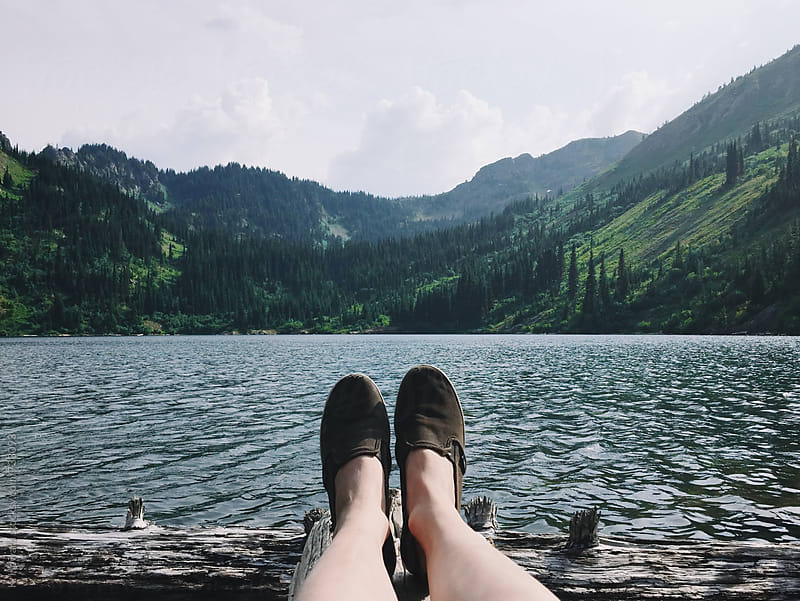 Feet over Lake. by K. Howard for Stocksy United