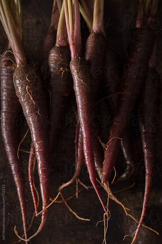 Purple Heirloom Carrots in Rustic Setting by Jeff Wasserman for Stocksy United