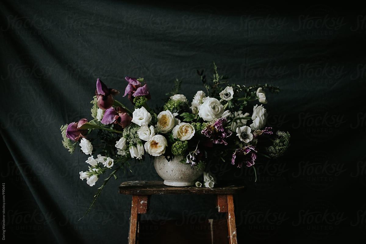 Dark And Moody Purple And White Wedding Flower Arrangement With Dark
