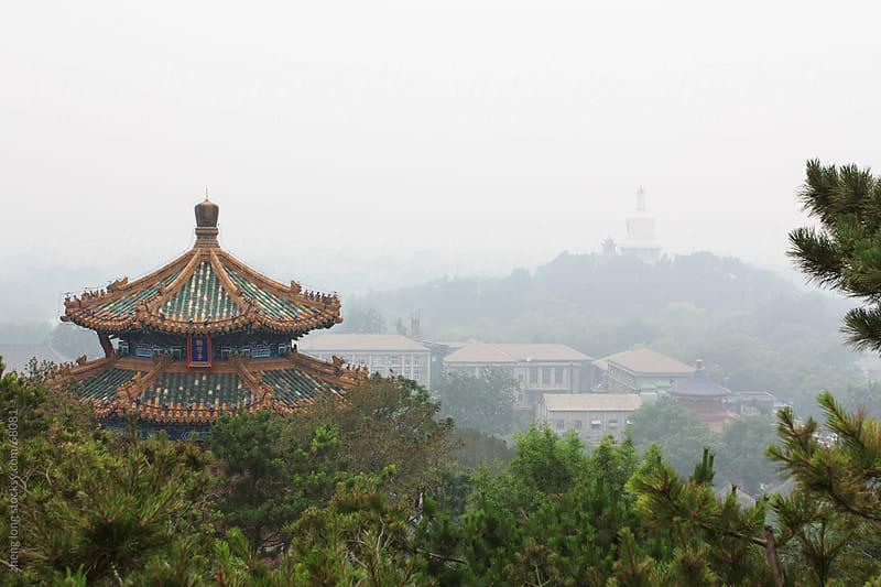 Beijing in haze by zheng long for Stocksy United