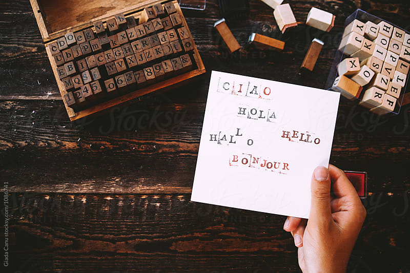 Woman write with stamps by Giada Canu for Stocksy United