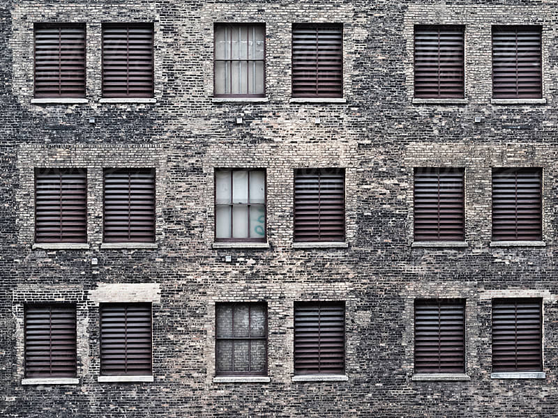 Facade of a stone building by Melanie Kintz for Stocksy United
