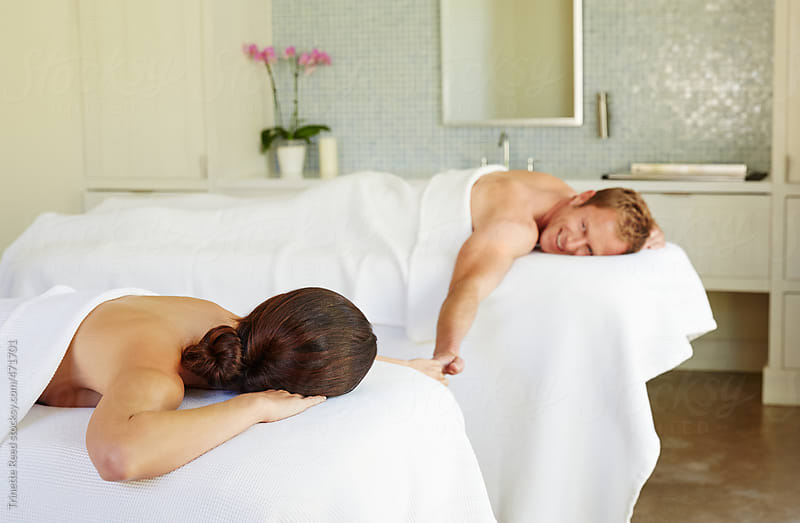 Couple receiving a couple's massage at luxury spa and resort by Trinette Reed for Stocksy United
