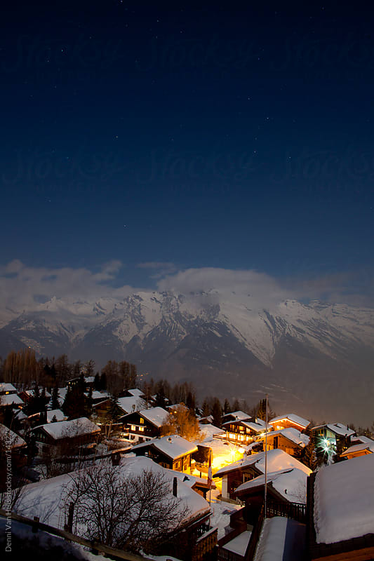 Snowy valley by night in the Alps by Denni Van Huis for Stocksy United