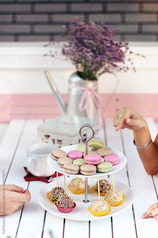 Beautiful macaroons on the table by Evil Pixels Photography for Stocksy United
