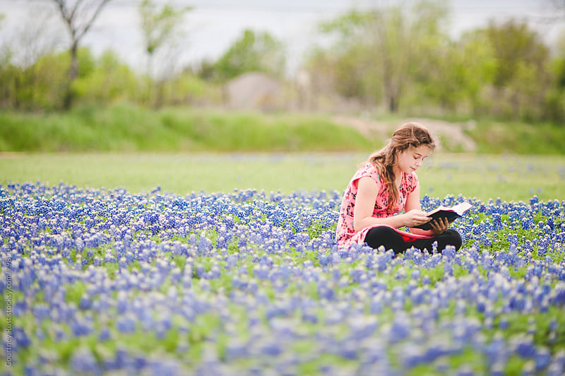 reading in the bluebonnets by Courtney Rust for Stocksy United
