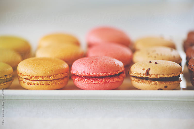 macarons in a row by Gillian Vann for Stocksy United