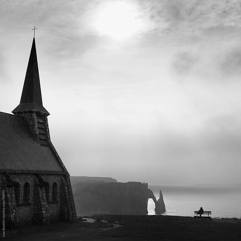 Chalk cliffs and old church in Etretat (Normandy, France) by Ivan Bastien for Stocksy United
