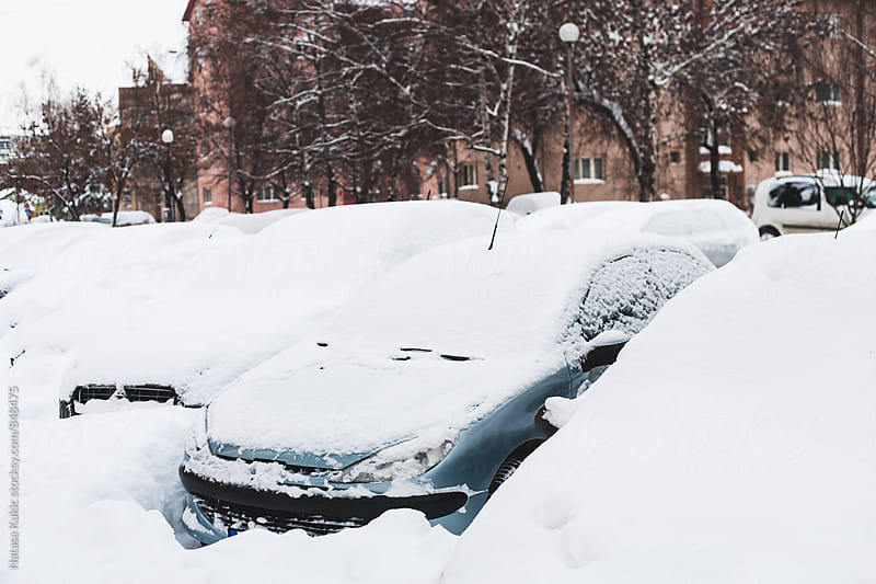 Cars stuck in the snow by Natasa Kukic for Stocksy United