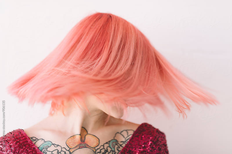 Happy young woman with pink hair by Alexey Kuzma for Stocksy United