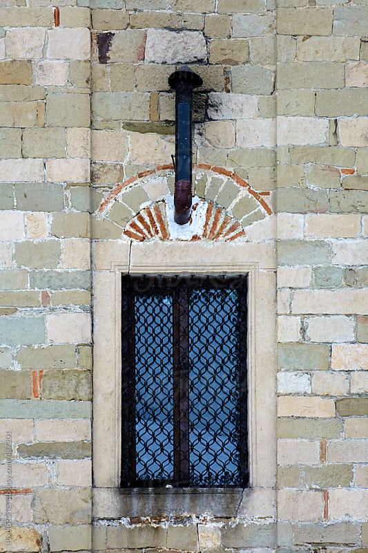 Window with chimney by Pixel Stories for Stocksy United