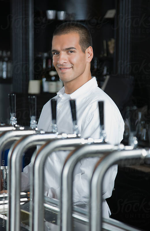 Portrait of smiling bartender in bar by Andersen Ross Photography for Stocksy United