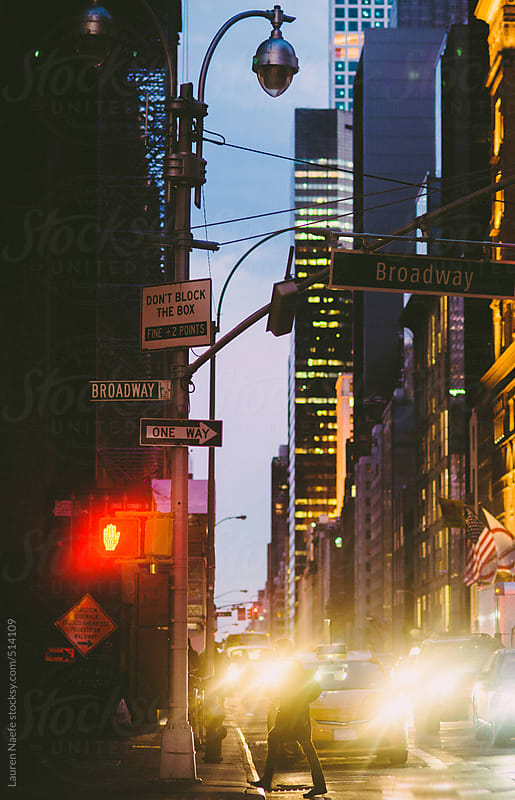Broadway street sign and busy traffic in New York City (NYC)  by Lauren Naefe for Stocksy United