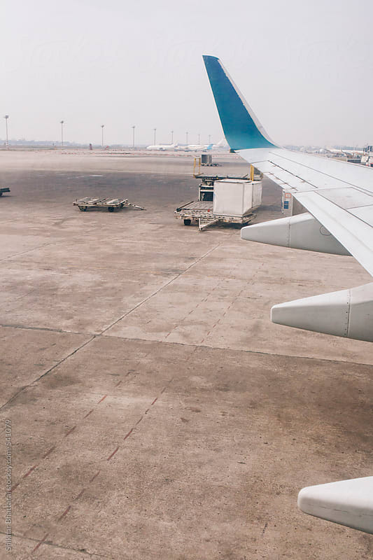 An aeroplane parked in the airport. by Shikhar Bhattarai for Stocksy United