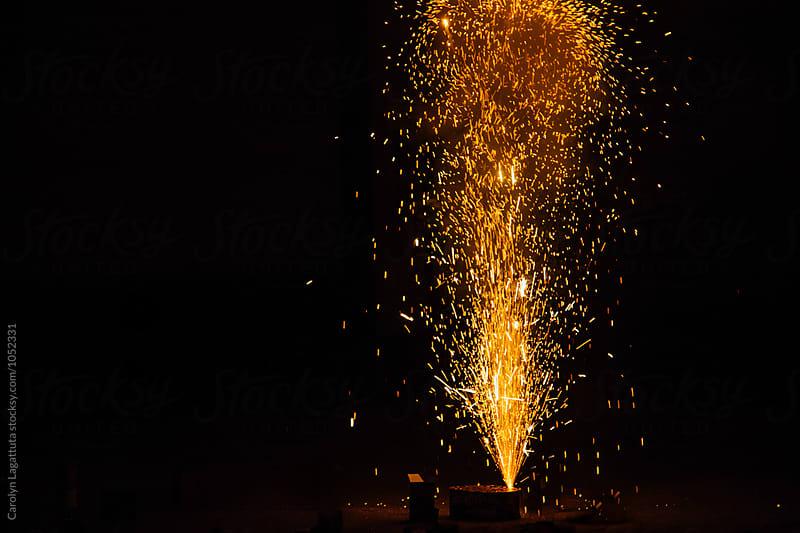 Fountain of sparks flying upward by Carolyn Lagattuta for Stocksy United