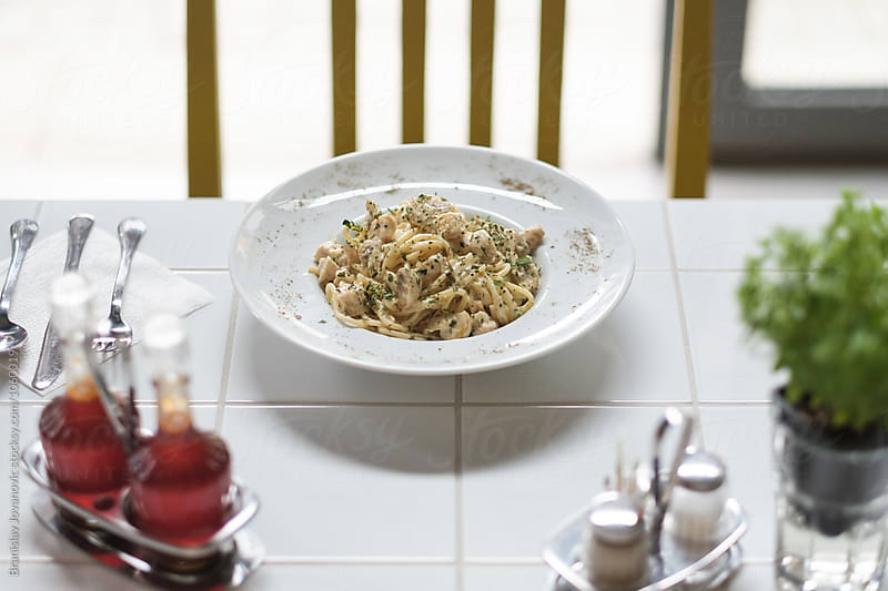 Pasta on the White Table at the Restaurant by Branislav Jovanovic for Stocksy United