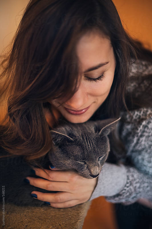 Woman Hugging Her Cat by Lumina for Stocksy United