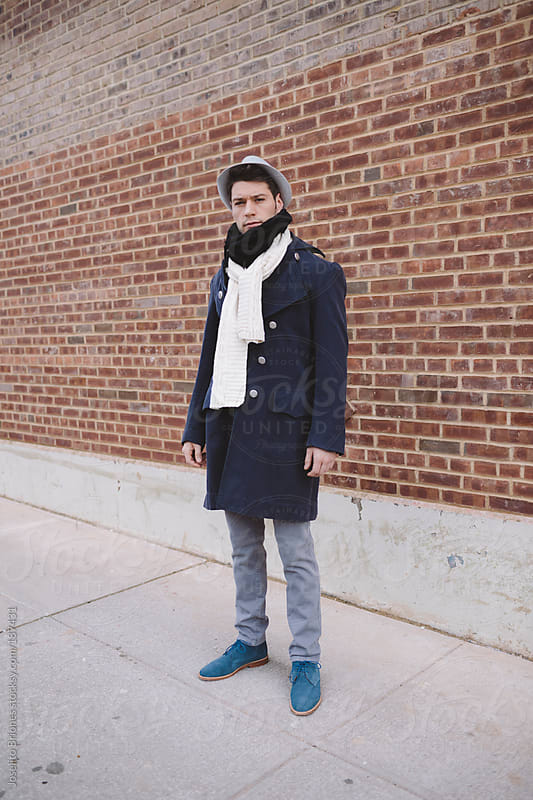 Street Style Male Fashion Photo in New York with Vintage Pirate Coat and oversized scarf by Joselito Briones for Stocksy United