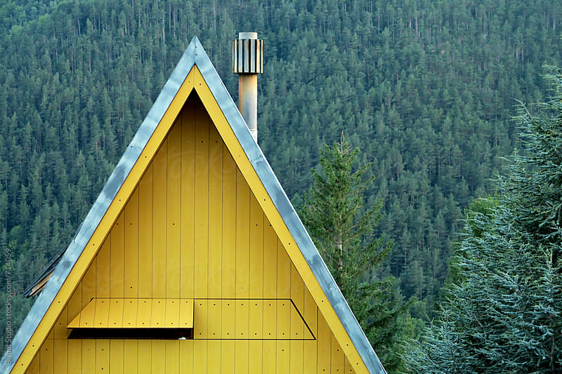 Yellow house in the mountains by Bisual Studio for Stocksy United