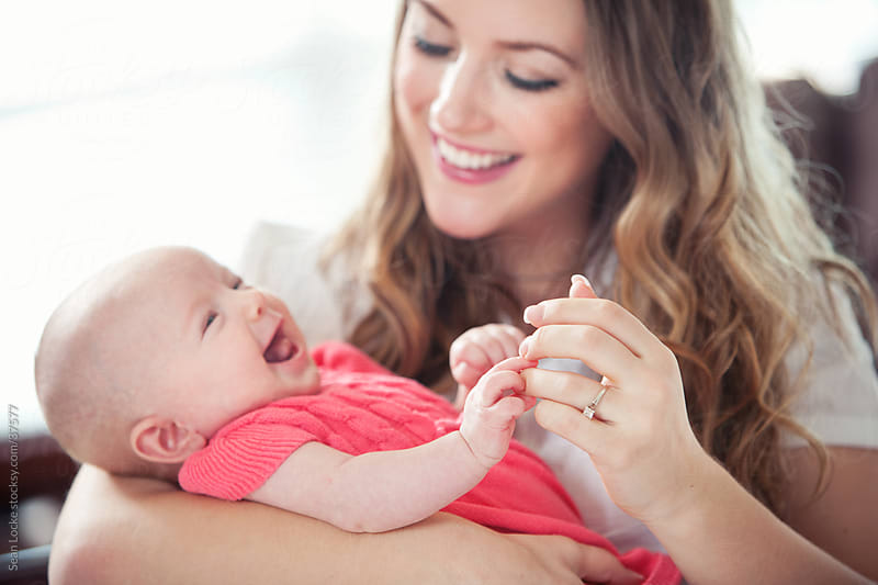 Baby: Mom and Baby Hold Hands by Sean Locke for Stocksy United