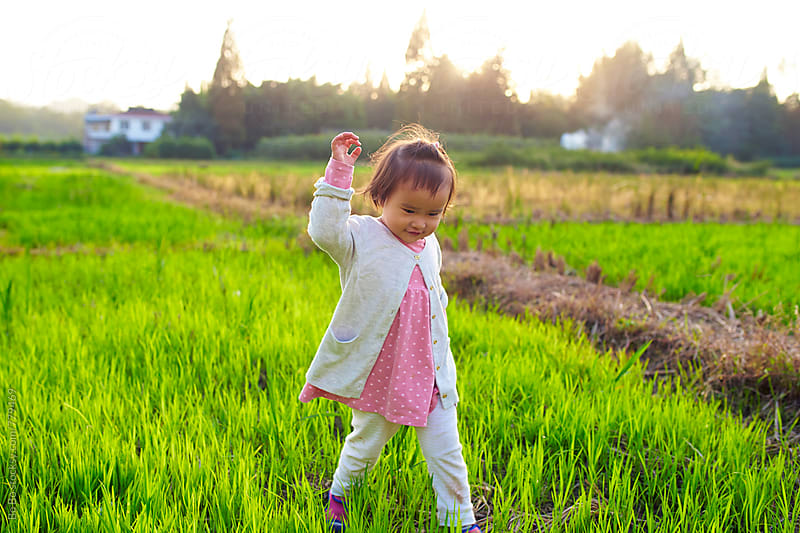 lovely little asian girl in the countryside by Bo Bo for Stocksy United