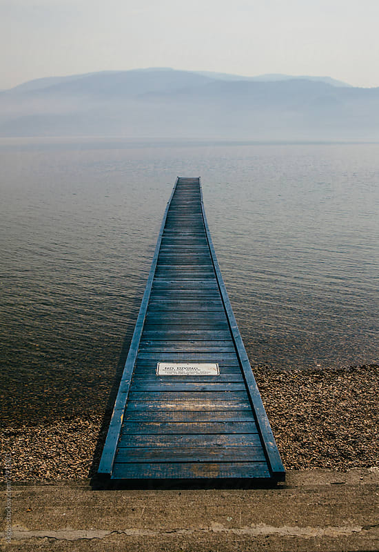 Lovely blue wooden pier into a lake by kkgas for Stocksy United