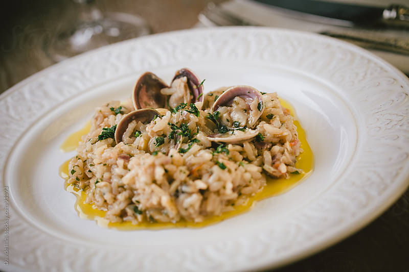 Seafood Risotto by Davide Illini for Stocksy United