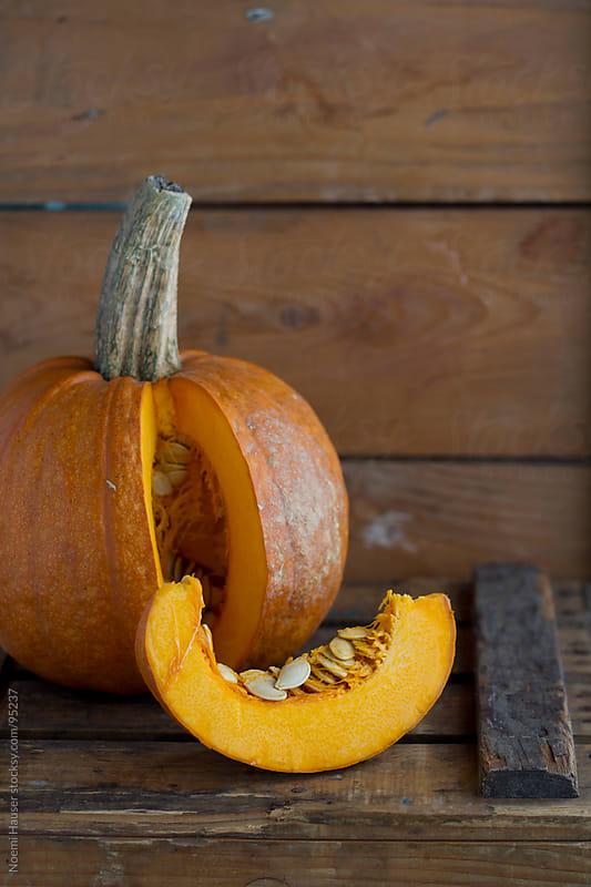 Sliced pumpkin by Noemi Hauser for Stocksy United