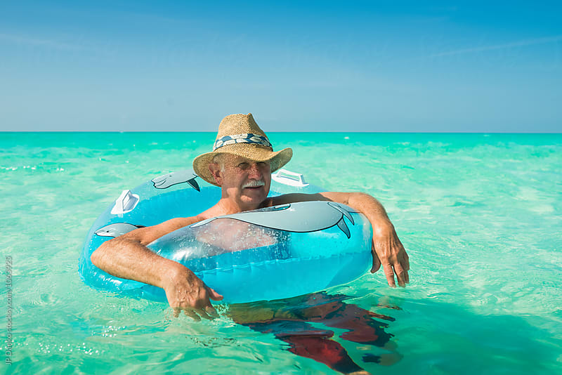 Old Man Tourist at Sunny Turquoise White Sand All Inclusive Resort Beach In Caribbean by JP Danko for Stocksy United