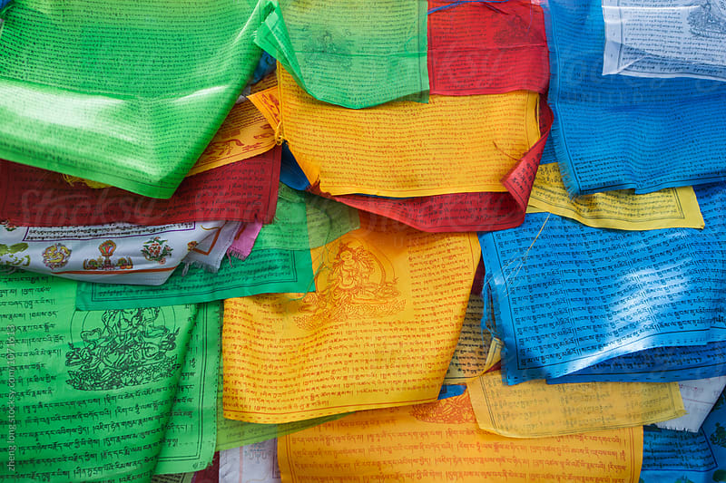 prayer flags on the mountain by zheng long for Stocksy United