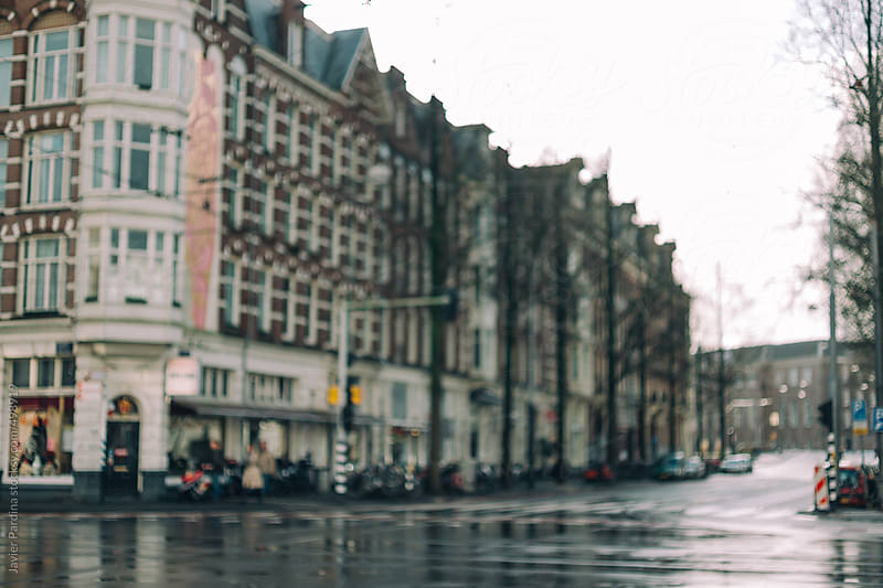 Wet streets of Amsterdam. by Javier Pardina for Stocksy United
