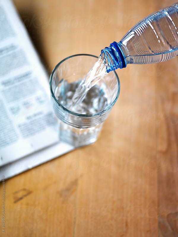 Water poured into a glass by J.R. PHOTOGRAPHY for Stocksy United