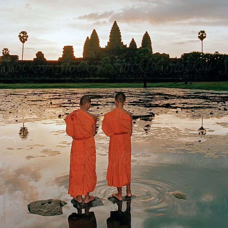 Buddhist monks standing in front of Angkor Wat, Angkor, UNESCO World Heritage Site, Siem Reap, Cambodia, Indochina, Asia by Gavin Hellier for Stocksy United