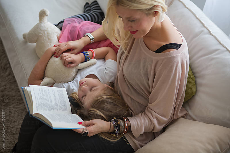 Mother Reading a Story to Her Daughter by Lumina for Stocksy United