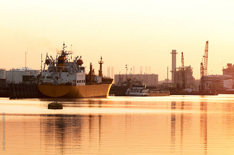 ships in the port of Rotterdam at sunset by Jan Bijl for Stocksy United