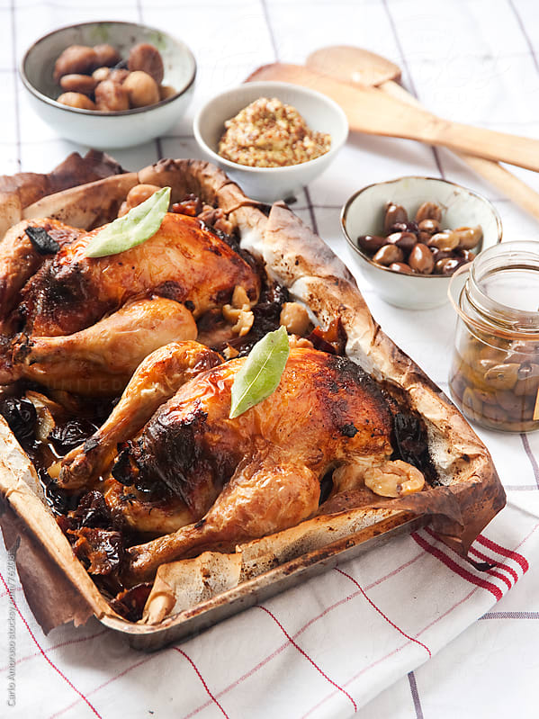 Quails stuffed with chestnuts  and prunes by Carlo Amoruso for Stocksy United