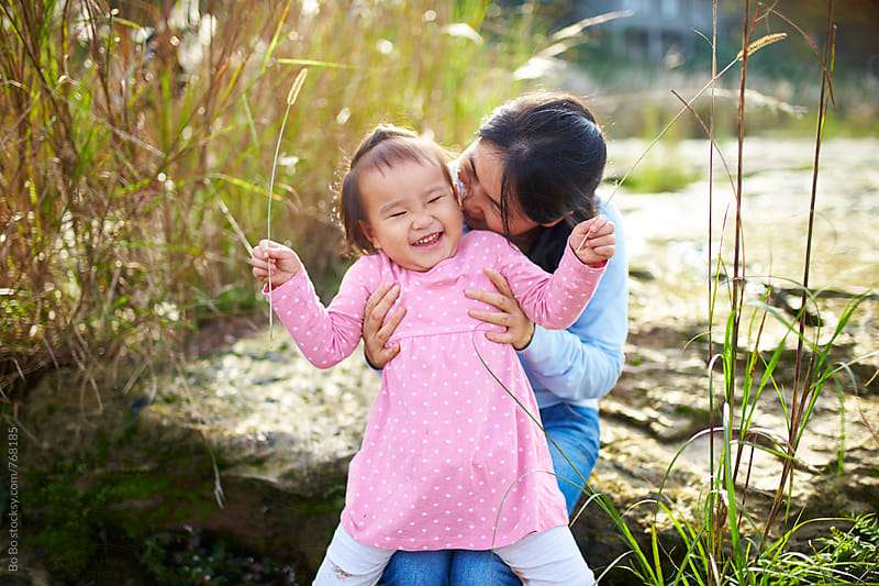happy asian little girl outdoor by Bo Bo for Stocksy United