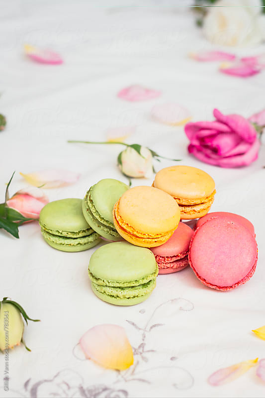 macarons in spring colours with roses by Gillian Vann for Stocksy United