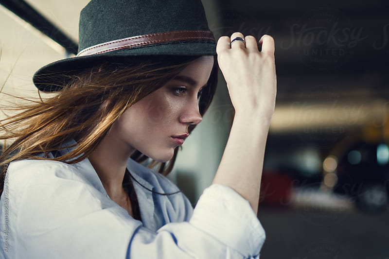 beautiful young girl in a hat by Andrei Aleshyn for Stocksy United