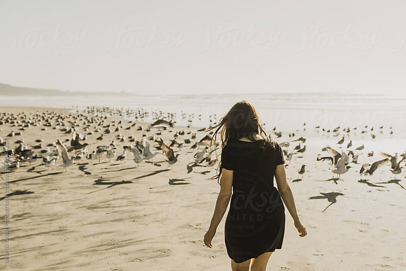 Girl Looking at Seagulls by Isaiah & Taylor Photography for Stocksy United