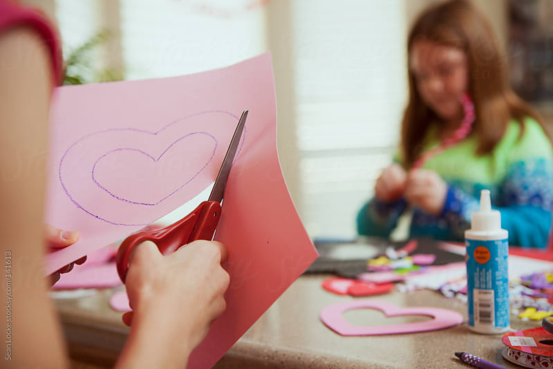 Valentine: Cutting Out A Paper Heart by Sean Locke for Stocksy United