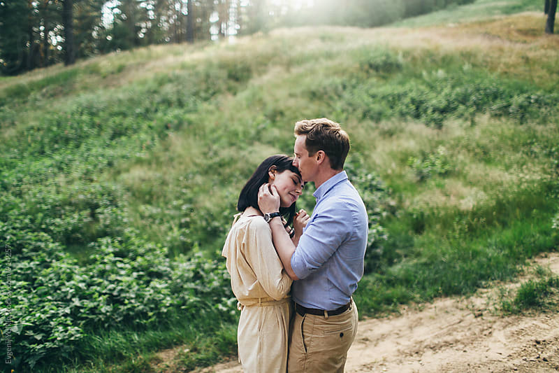 Young couple in the forest by Evgenij Yulkin for Stocksy United