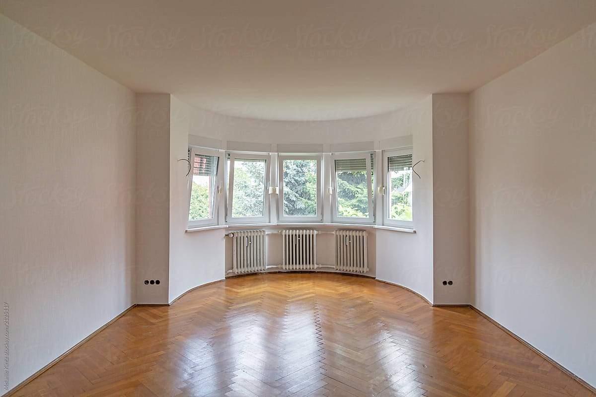 Empty Room With Large Bay Window And Hardwood Floor After